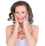 Happy young woman painting herself Royalty Free Stock Photography