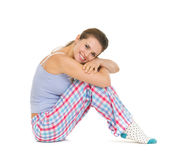 Happy young woman in pajamas sitting on floor Royalty Free Stock Photography