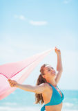 Happy young woman with parero rejoicing on beach Royalty Free Stock Photos