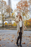 Happy young woman in Paris, France using mobile phone Royalty Free Stock Photography