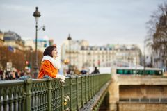 Happy young woman in Paris Stock Image