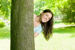 Happy young woman in park. Portrait of beautiful happy young woman in park Royalty Free Stock Image