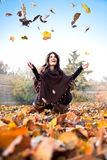 Happy young woman in the park. Happy young woman in the autumn colored park stock photos