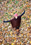 Happy young woman in the park. Happy young woman in the autumn colored park stock photography