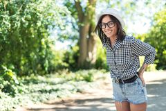 Happy young woman in the park - nature. Smile lovely girl royalty free stock photos