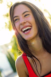 Happy young woman at the park. Portrait of happy young woman at the park Stock Photos