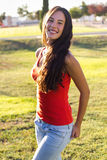 Happy young woman at the park. Portrait of happy young woman at the park Stock Image