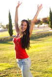 Happy young woman at the park. Portrait of happy young woman at the park Royalty Free Stock Photography