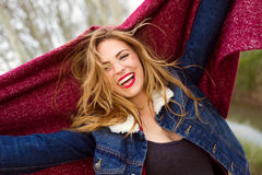Happy young woman in the park. Portrait of happy young woman in the park Royalty Free Stock Photography