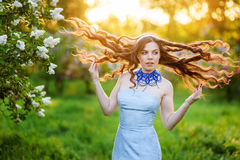 Happy young woman in a park in spring lilac Stock Photo