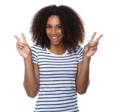 Happy young woman with peace sign Royalty Free Stock Image