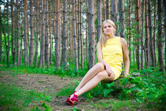 Happy young woman in a pine forest in summer Royalty Free Stock Images
