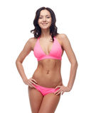 Happy young woman in pink bikini swimsuit Royalty Free Stock Photo
