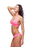 Happy young woman in pink bikini swimsuit Royalty Free Stock Images