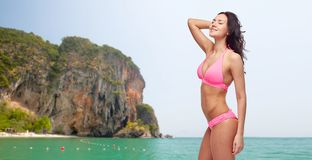 Happy young woman in pink bikini swimsuit Royalty Free Stock Photos