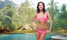 Happy young woman in pink bikini swimsuit Stock Image