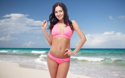 Happy young woman in pink bikini swimsuit Stock Photography