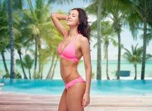 Happy young woman in pink bikini swimsuit Stock Photo