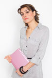 Happy young woman with pink netbook Royalty Free Stock Image