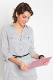 Happy young woman with pink netbook Stock Photos