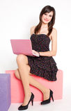 Happy young woman with pink netbook Royalty Free Stock Photography
