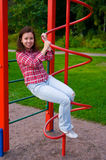 Happy young woman on playground Stock Images