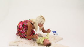 Happy Young Woman Playing With Her Small Baby Boy stock footage