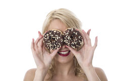 Happy Young Woman Playing with Iced Chocolate Donuts Over Eyes Stock Images