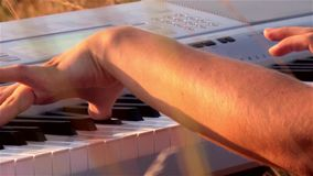 Happy young woman playing the piano at the field stock video footage