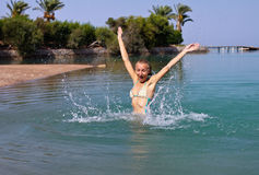 Happy young woman playing in the sea Royalty Free Stock Images