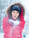 Happy young woman plays with a snow Royalty Free Stock Photography