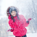Happy young woman plays with a snow Stock Photography