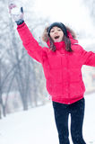 Happy young woman plays with a snow Royalty Free Stock Photo