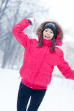 Happy young woman plays with a snow Stock Photo