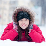 Happy young woman plays with a snow Royalty Free Stock Photos