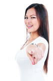Happy Young Woman Pointing Royalty Free Stock Photos