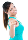 Happy Young Woman Pointing. Portrait of cute young woman pointing at you over white background Stock Photos