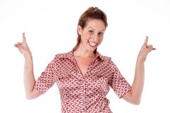 Happy young woman pointing back at copyspace Stock Photo