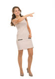 Happy young woman pointing on copy space Stock Photos