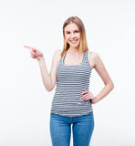 Happy young woman pointing finger away Stock Image