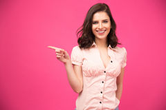 Happy young woman pointing finger away Stock Photography