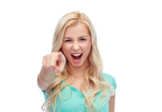 Happy young woman pointing finger to you Royalty Free Stock Images