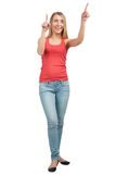Happy young woman pointing up Stock Images