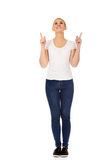 Happy young woman pointing up with both hands Royalty Free Stock Photos