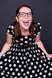 Happy young woman in polka-dot dress Stock Images