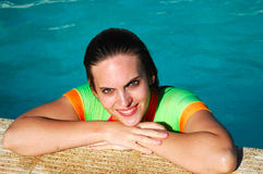 Happy young woman in pool Royalty Free Stock Photos