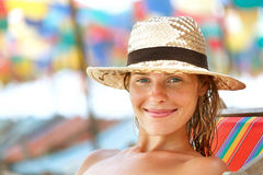 Happy young woman posing while on the beach Stock Images