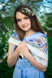 Happy young woman posing in blooming summer garden Royalty Free Stock Image