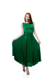 Happy young woman posing in bright green dress Stock Photo