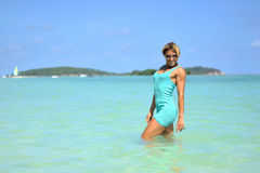 Happy young woman posing by the sea Stock Image